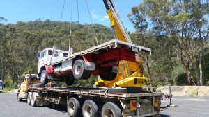 truck lifting car crane